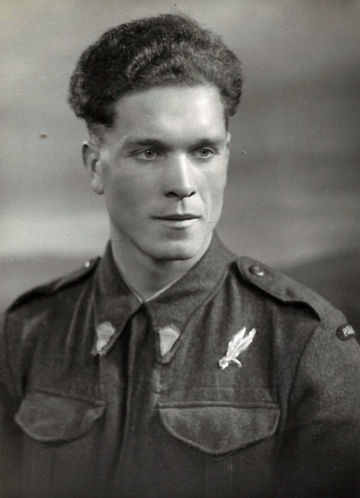 Antoni Paszkiewicz wearing his parachute qualification badge and parachute collar badges