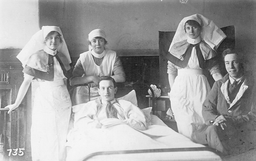 Three nurses and two wounded men